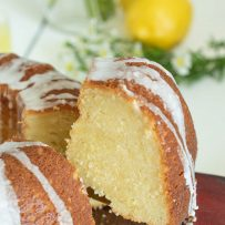 A fluffy and yellow slice of limoncello cake on a cake slicer