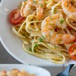 Linguine with shrimp in a white bowl with a closeup