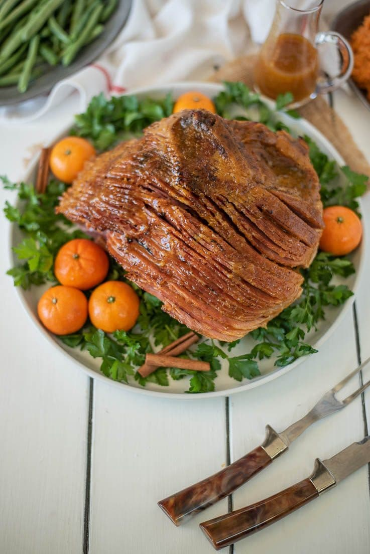 The ham from overhead showing the crispy slices fanned open