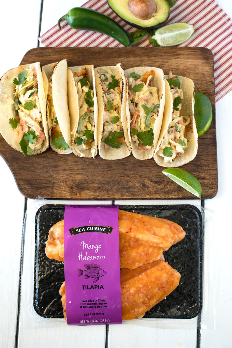 Mango habanero tilapia tacos with cilantro lime slaw are tacos with a lot of flavor. Fast and easy to make, delicious mango habanero tilapia filets are cooked from frozen in 15-20 minutes, then topped with a creamy and flavorful slaw.