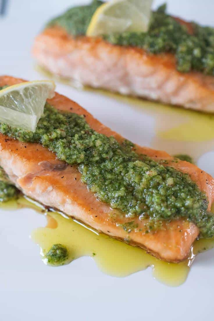A closeup showing the vibrant green pesto on the salmon