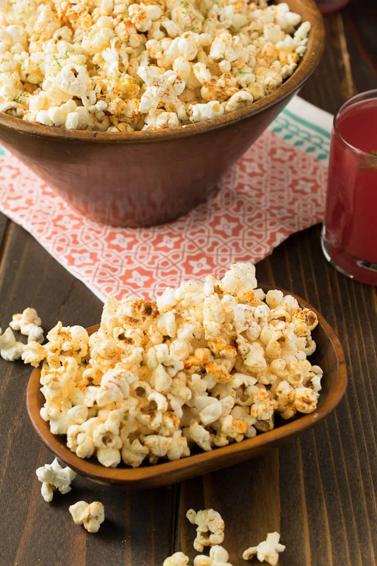A small wooden bowl and a large round bowl filled with Mexican popcorn
