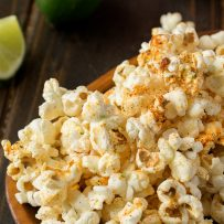 Yummy spices on top of popcorn with flecks of lime zest