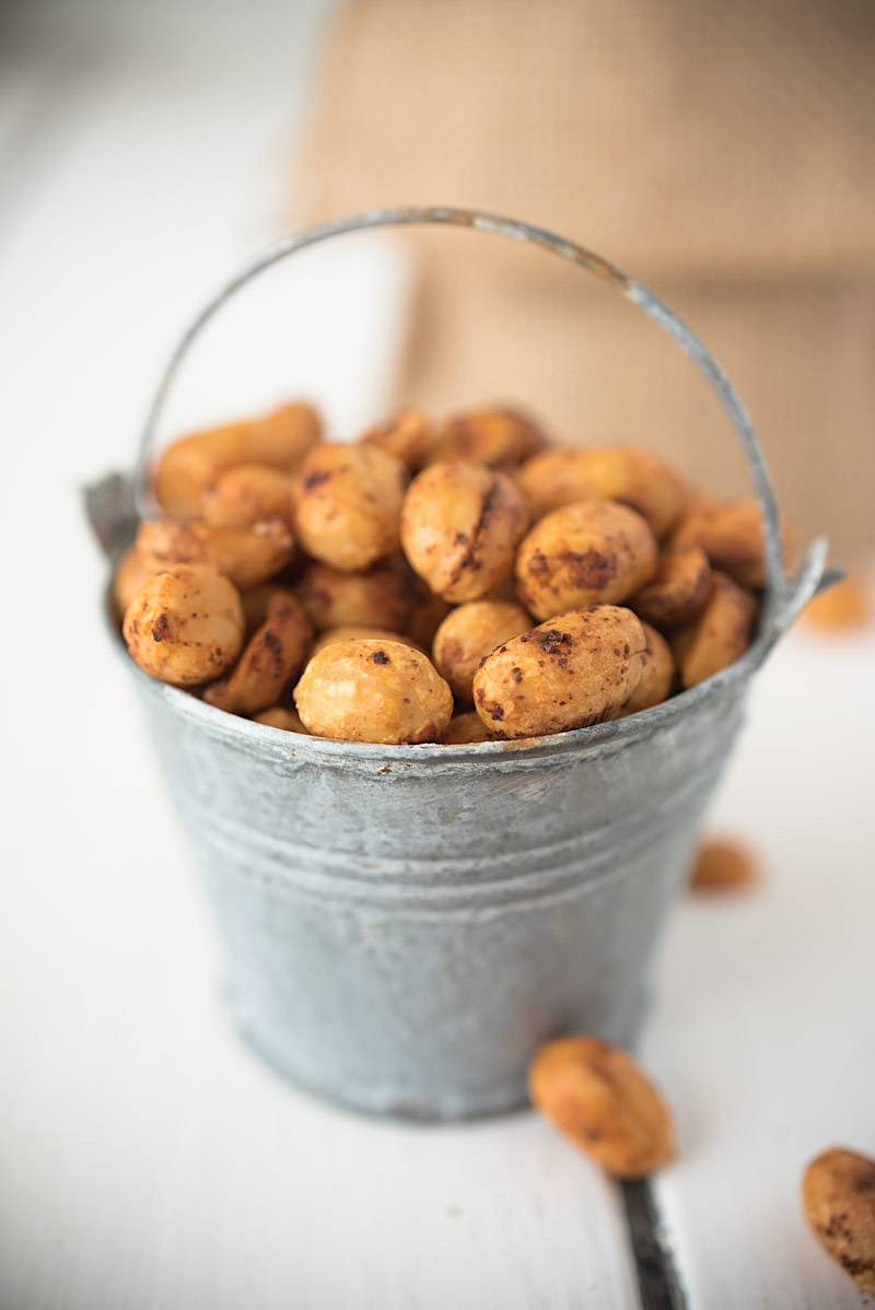 Peanuts coated in fresh lime juice, zest, ancho chile powder, roasted then salted. These Mexican chile lime peanuts will become your new, favorite snack.