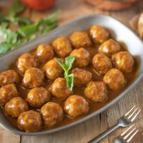 Small chicken meatballs cooked in coconut curry sauce