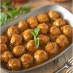 Mini meatballs in a curry coconut sauce garnished with fresh mint