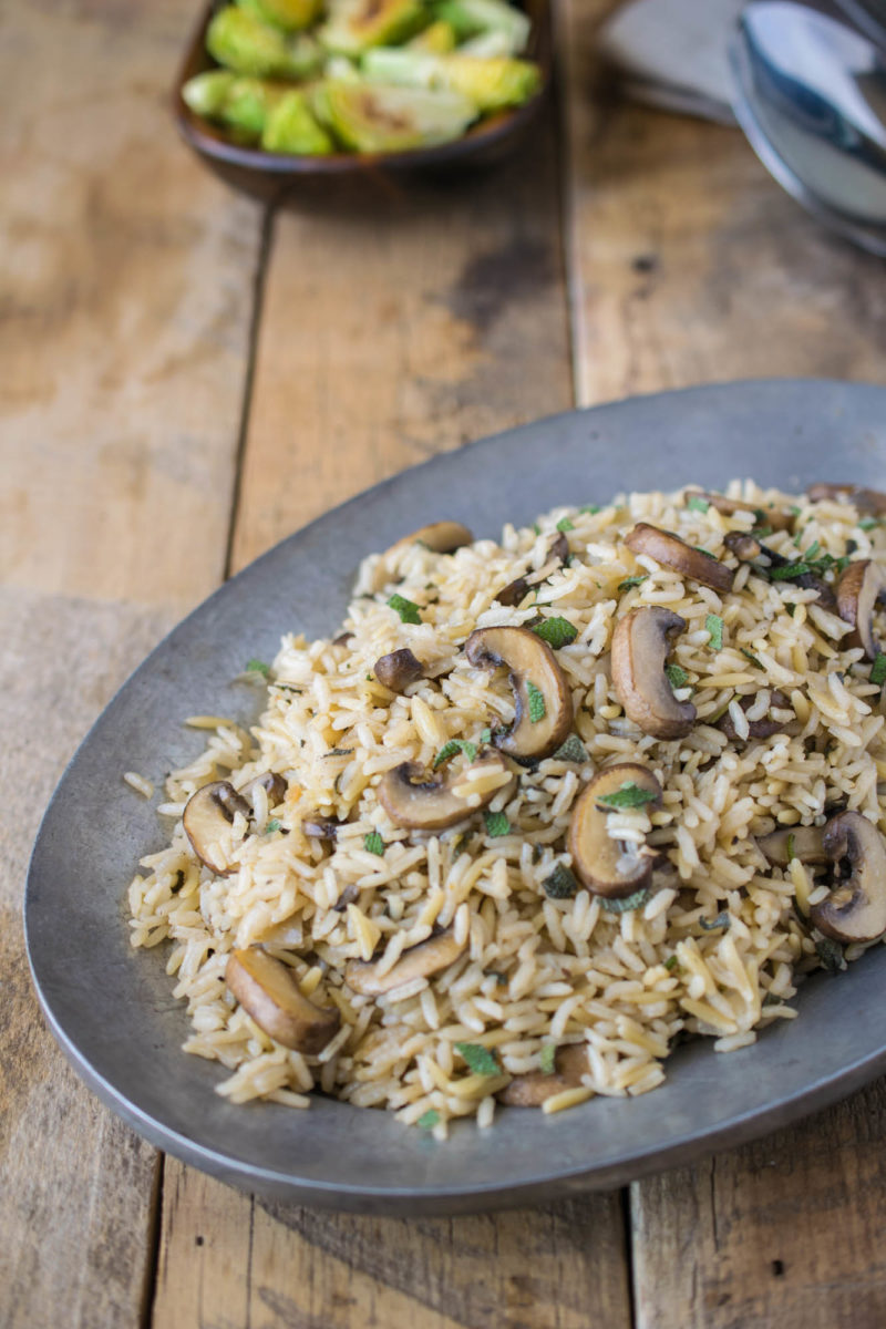 Mushroom and sage rice pilaf on a silver plate