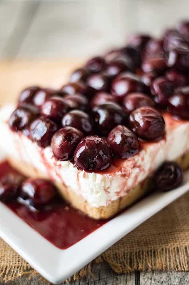 A closeup of the dark cherries on top of the cherry lemon cheesecake