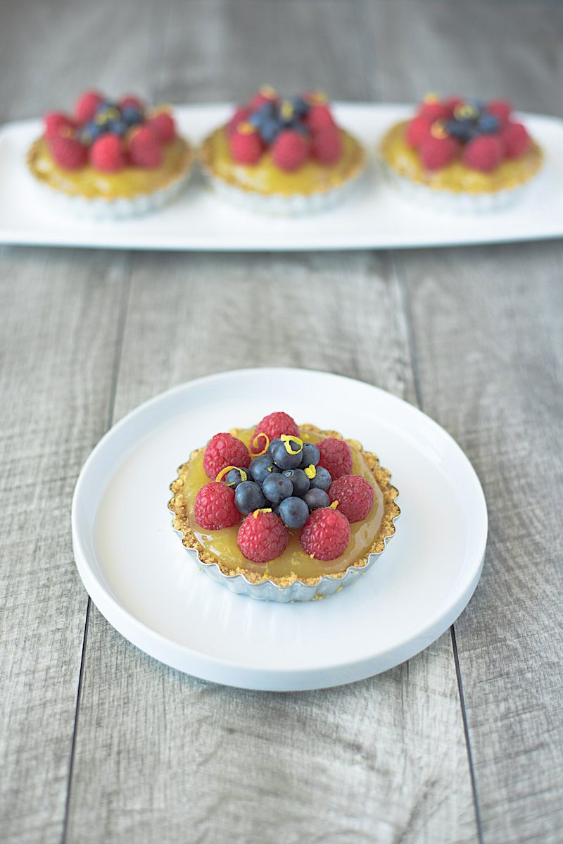 No bake berry lemon tartlets are an easy and very spring-like dessert. With a lemon graham cracker crust, delicious lemon curd filling and topped with fresh berries these tartlets are brightly colored berry treats.