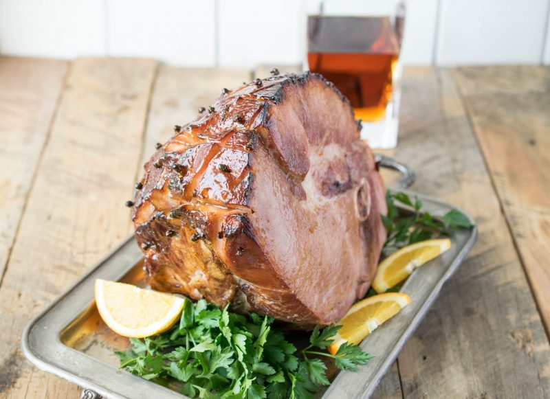 Orange & bourbon glazed ham is the star of any holiday table. A perfectly baked ham with a delicious sweet, tasty glaze that also has a presentation wow factor.
