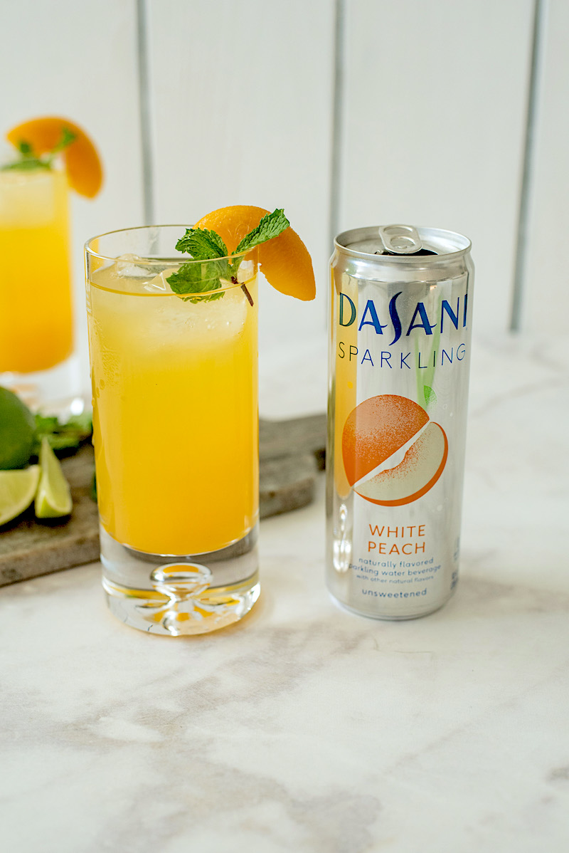 This peachy keen gin fizz is a delicious drink that can be enjoyed spring, summer or a festive event like a bridal shower. It's peachy and delicious with a extra fizz from Dasani Sparkling White Peach.
