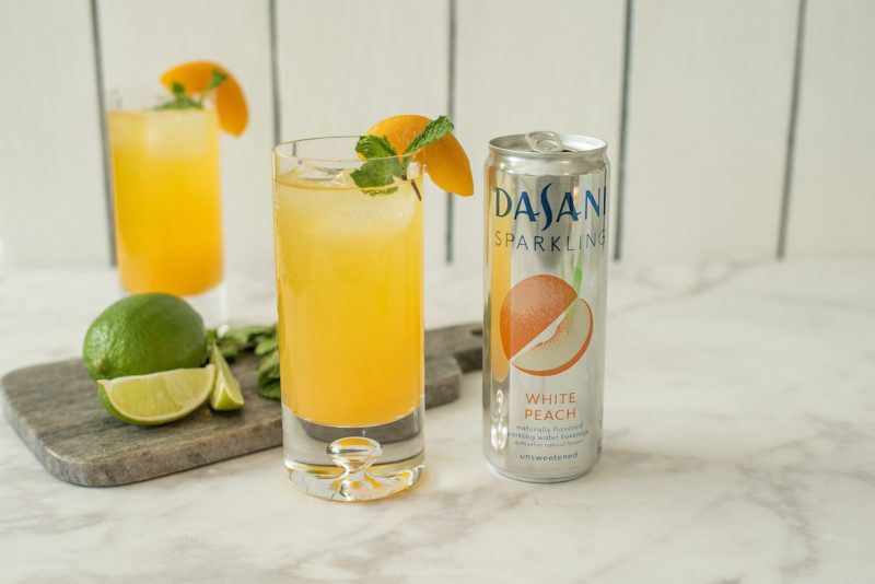 This peachy keen gin fizz is a delicious drink that can be enjoyed spring, summer or a serve for a festive event like a bridal shower. It's peachy and delicious with a extra fizz from Dasani Sparkling White Peach.