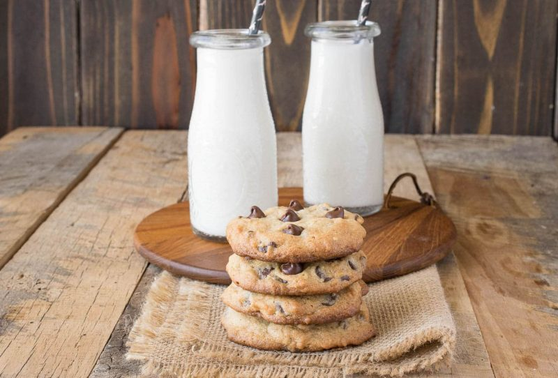 A side shot of a stack of cookies with milk