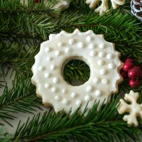 A peppermint sugar cookies decorated with winter white on white frosting