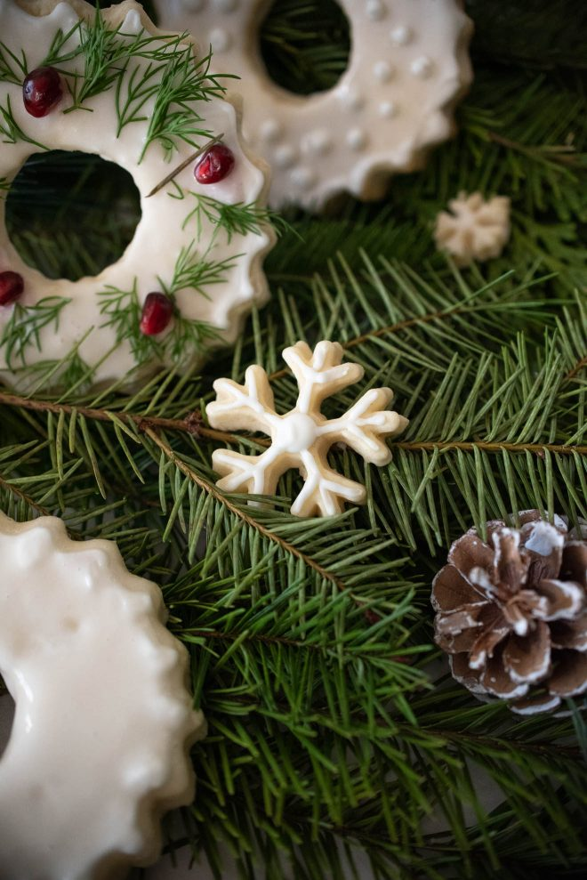 A small snowflake cookie frosted with white icing