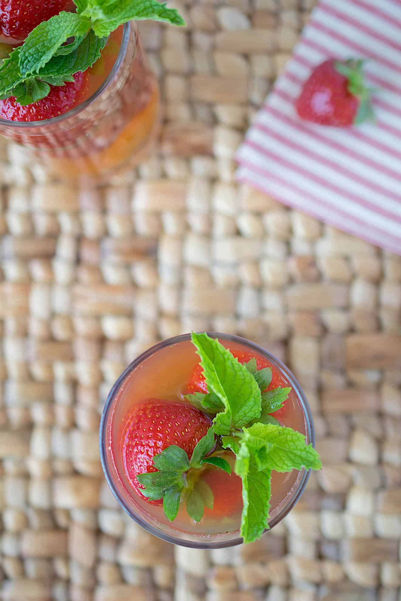 The drink viewed from overhead showing the green mint leaves and beautiful strawberry