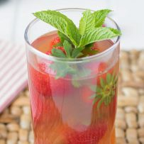 A closeup of Pimm's Strawberry Mint Cockatail