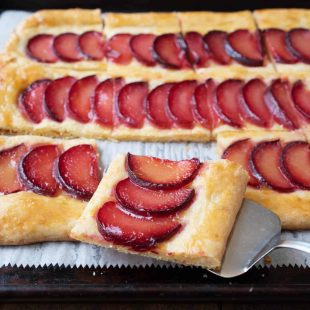 A square slice of plum tart with cornmeal crust