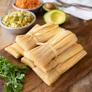 Tamales with fresh cilantro, corn, rice and avocado
