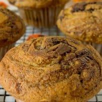 A closeup of a pumpkin muffin that has nutella swirled all through