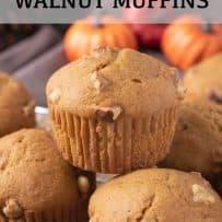 Golden brown pumpkin walnut muffins with crunchy pieces of walnut poking through