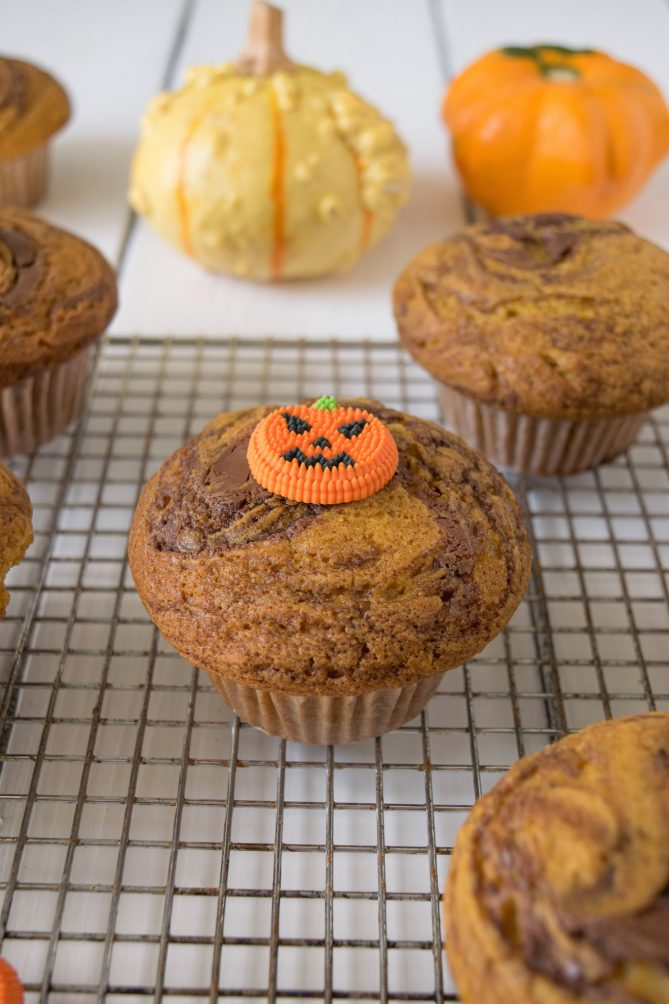 A pumpkin nutella muffin with a candy pumpkin on top