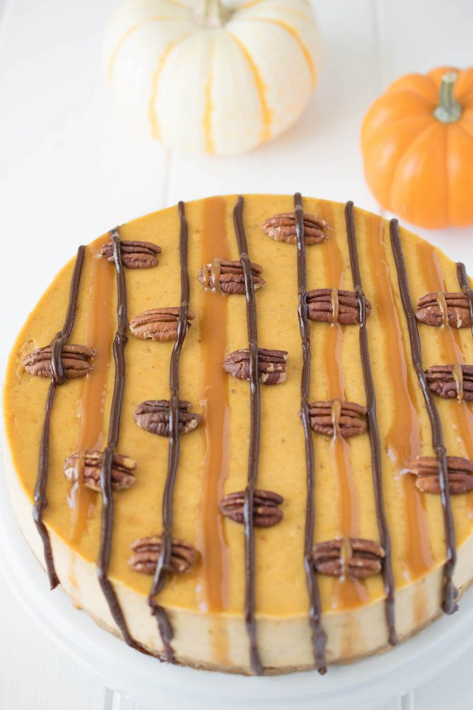A closeup showing the top with caramel and chocolate and roasted pecans