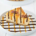 Pumpkin turtle cheesecake is an extra creamy cheesecake with a graham cracker crust made New York style. Topped with caramel, chocolate sauce and toasted pecans, this is cheesecake taken to a new level.