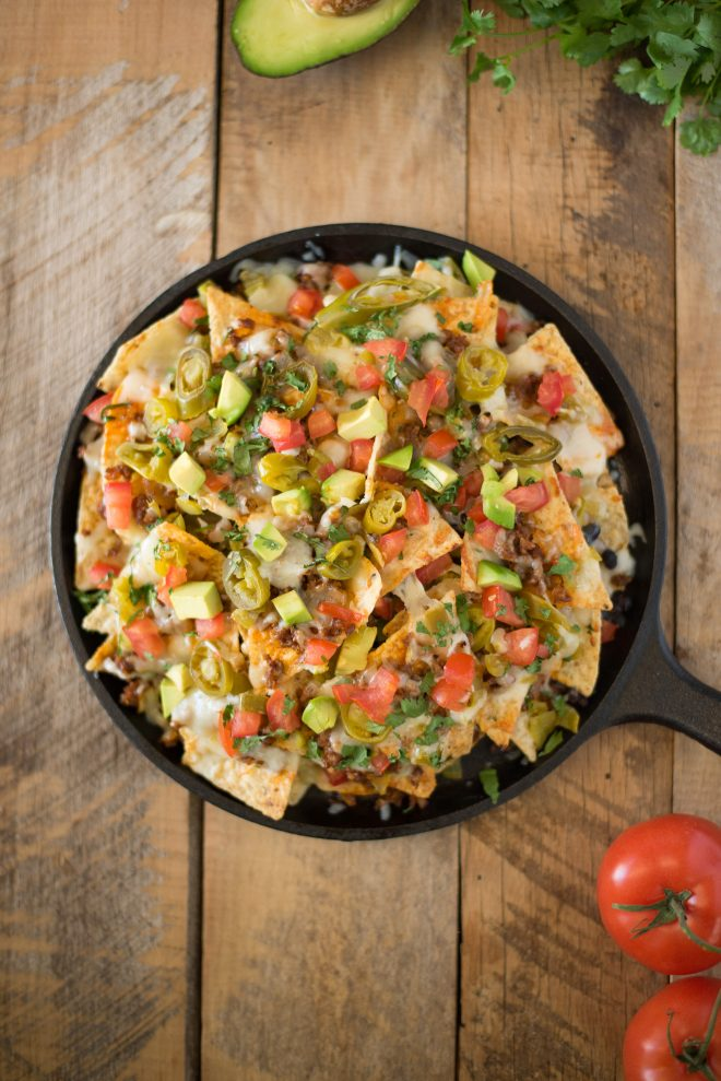 Queso fundido skillet nachos viewed from overhead