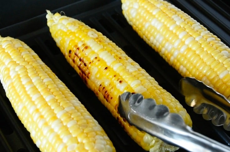 Corn on the cob being grilled
