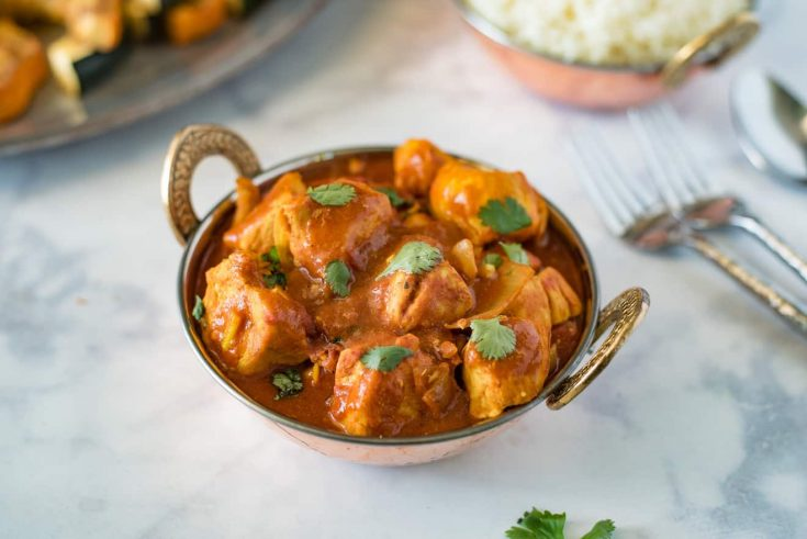 Quick and easy chicken madras in a copper serving dish