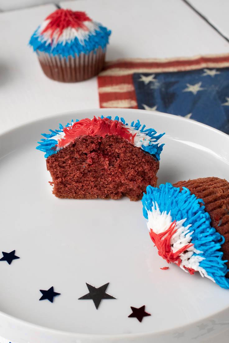 Red velvet cupcake broken in half showing the center