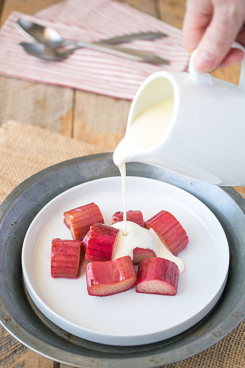 Rhubarb and custard is a sweet, tart, creamy and comforting dessert. Fresh rhubarb is roasted with sugar to get sweet and release its delicious juice then topped with warm, thick English custard.