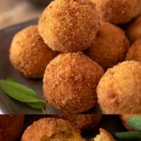 Golden, crispy rice balls with one opened up with stringy cheese