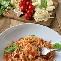 Twirling linguine and tomato sauce with a fork
