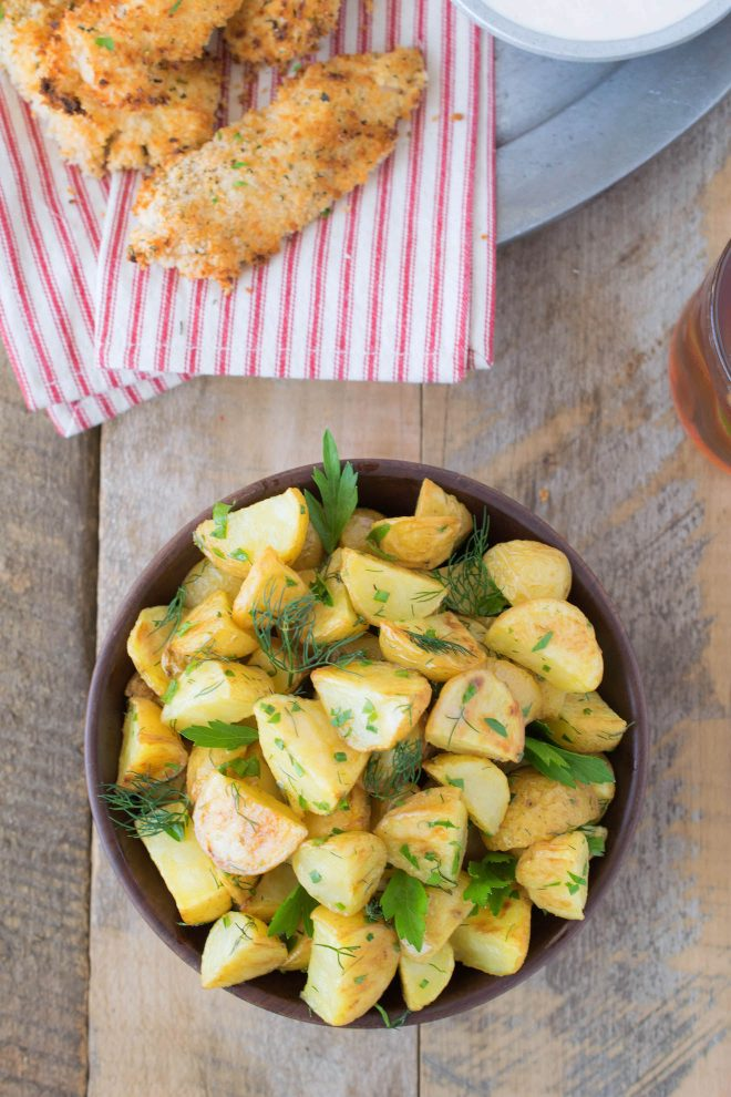 Roasted potatoes with herbs viewed from overhead