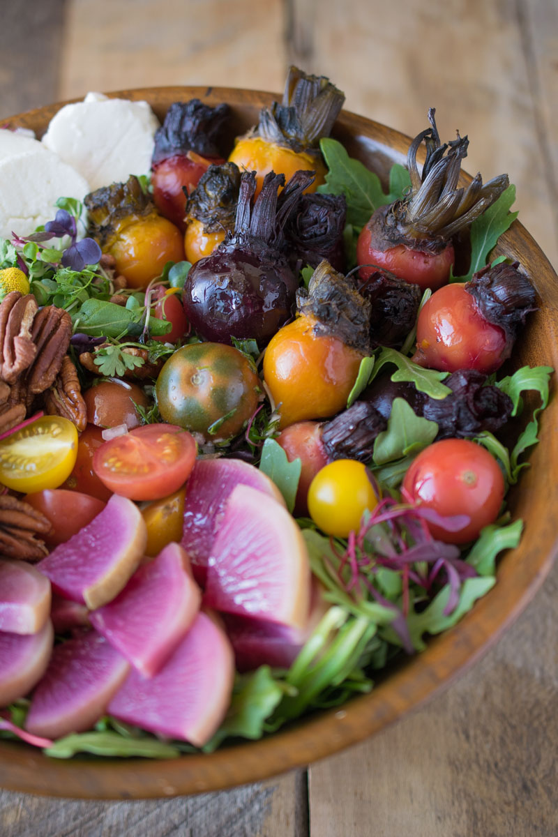 A closeup showing beautiful fresh vegetables in a salad bowl