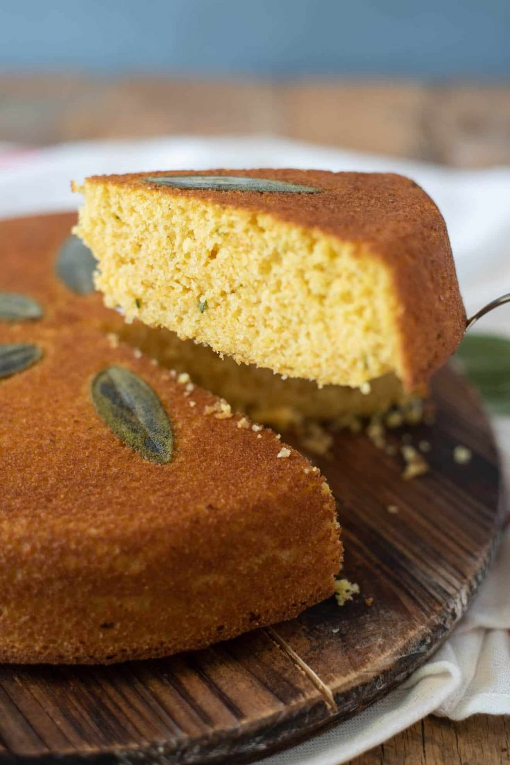 A slice of Sage Cornbread showing flecks of fresh sage on the inside