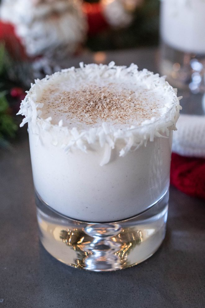Santa's Rum Spiked Milk with a coconut rim and dusted with nutmeg