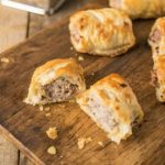 Homemade sausage rolls on a board