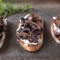 3 sautéed mushroom and rosemary bruschetta on a serving platter