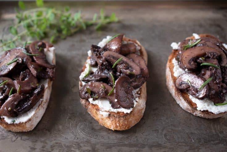 3 sautéed mushroom and rosemary bruschetta on a serving platter