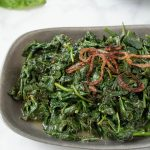 Browned, crispy shallots on top of sauteed spinach