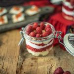 Scottish raspberry trifle dip in a sealable glass jar ready to be taken on a picnic
