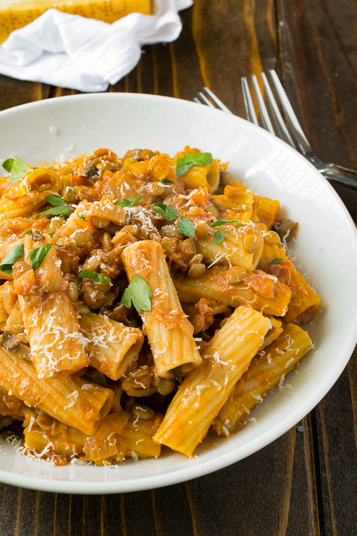 A closeup showing the large rigatoni pasta coasted in lentil sauce