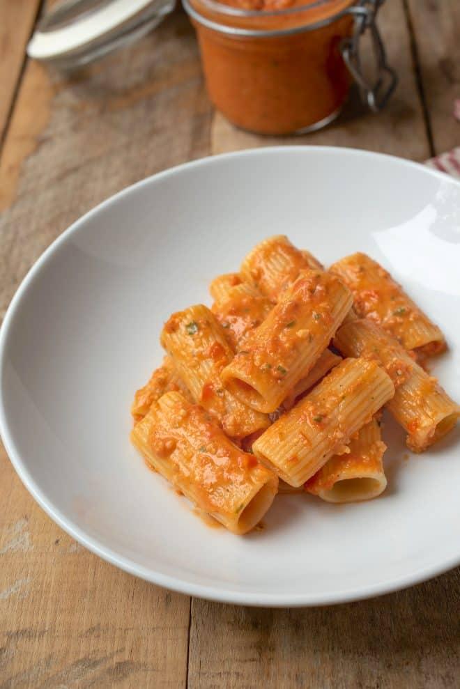 Rigatoni and Sicilian pesto sauce in a white bowl