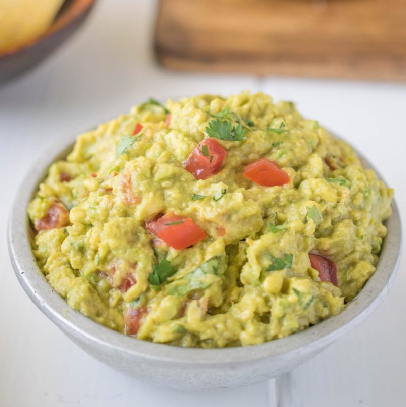 Signature guacamole with fresh tomatoes and cilantro