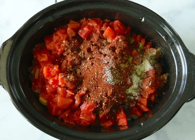 Cumin, coriander, oregano, chili powder, salt & pepper are added
