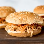 Slow cooker Asian chicken sandwiches on a board