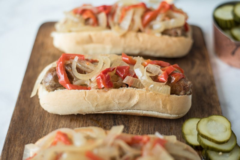 Slow cooker  beer brats with peppers and onions are the perfect, easy cookout meal for a crowd. Brats are slow cooked in German beer along with peppers and onions, pile onto a bun and you're set.